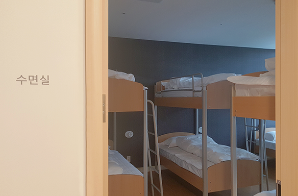 It is a photo of the sleeping room. There are bunk beds.