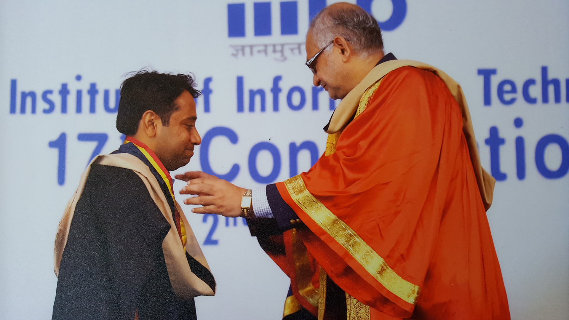 An award medal is being given to an awardee.